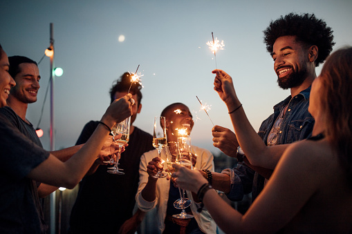 Friends celebrating at party on rooftop 1045993746