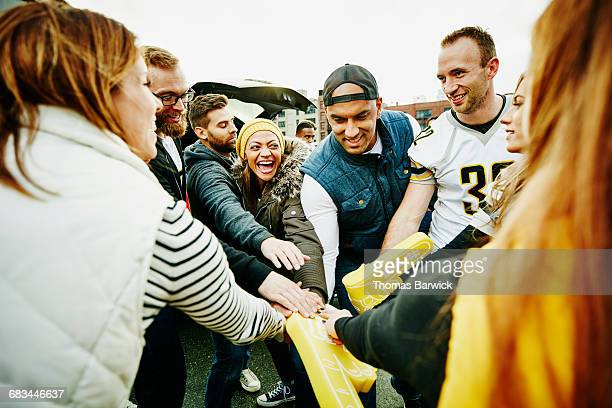 friends celebrating at tailgating party - foam finger stock photos and pictures