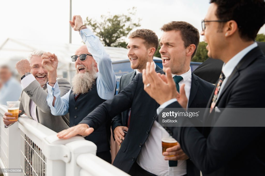 Friends Celebrating At The Races : Stock Photo