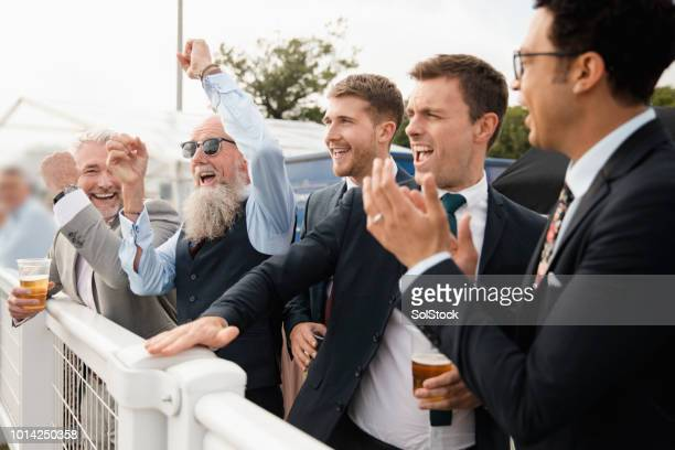 friends celebrating at the races - horse racing stock pictures, royalty-free photos & images
