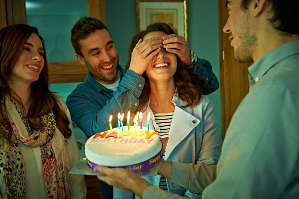 friends celebrating birthday at home - best friend birthday cake stock pictures, royalty-free photos & images