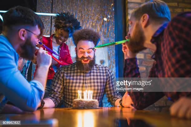 Friends celebrating birthday in the pub