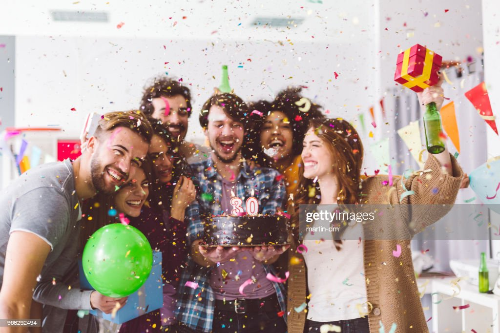 Friends celebrating birthday party in the office : Stock Photo