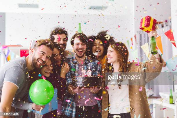 friends celebrating birthday party in the office - happy birthday stock pictures, royalty-free photos & images