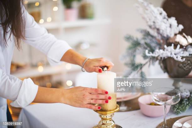 friends celebrating christmas at home - christmas decore candle stock pictures, royalty-free photos & images