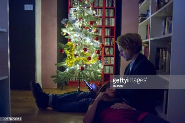 Friends celebrating Christmas: Couple relaxing