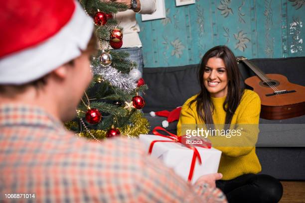 Friends celebrating Christmas: Giving presents
