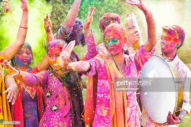 friends celebrating holi festival in india - holi stock pictures, royalty-free photos & images
