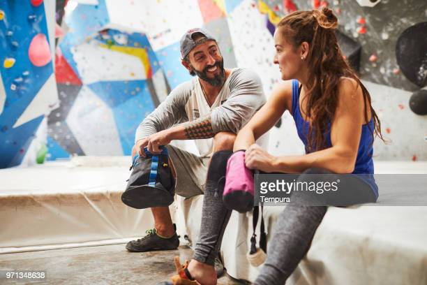 friends celebrating indoor bouldering training. - chalk bag stock pictures, royalty-free photos & images