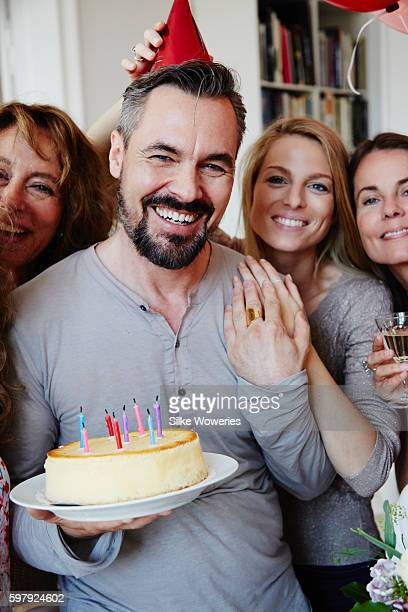 friends celebrating middle-aged man's birthday