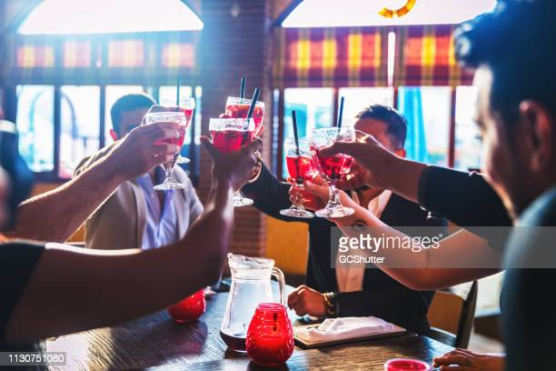 friends celebrating moments of togetherness - sangria stock pictures, royalty-free photos & images