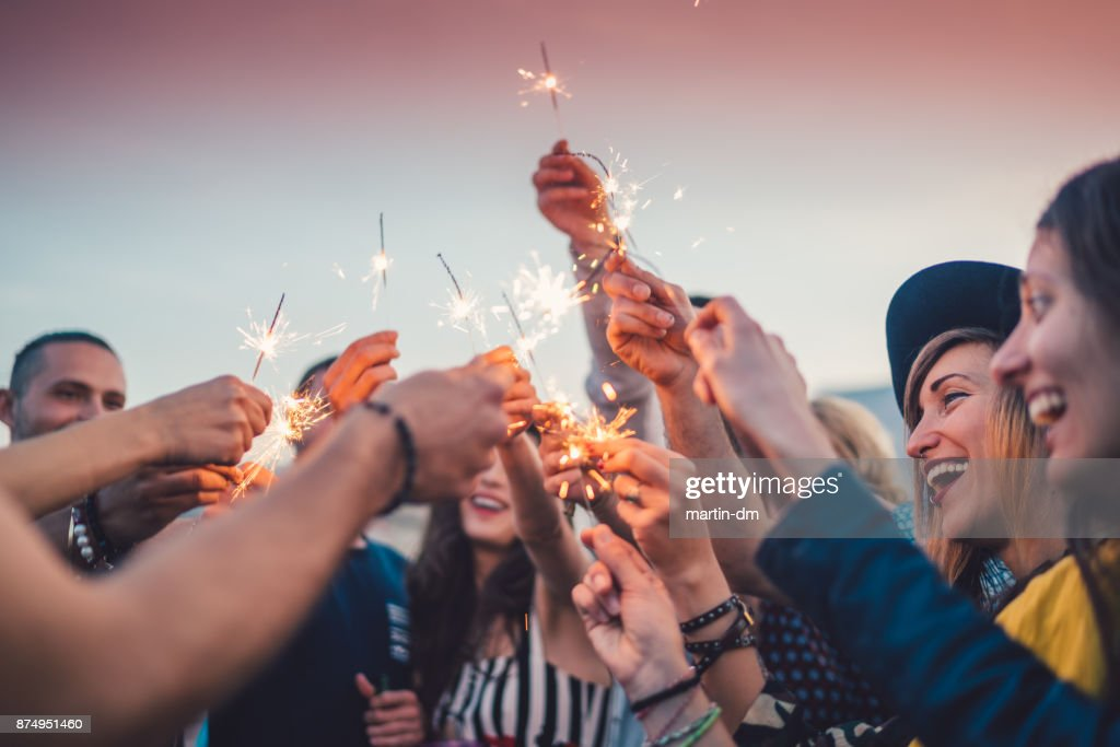 Friends celebrating New Year : Stock Photo