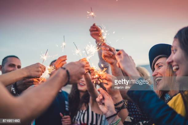 friends celebrating new year - celebration stock pictures, royalty-free photos & images