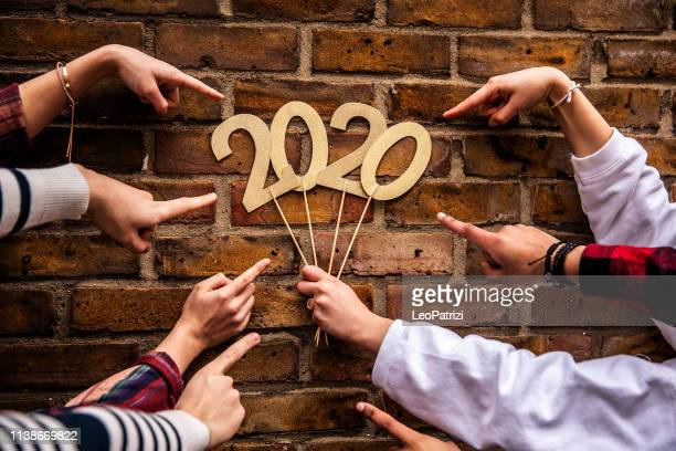 friends celebrating new year's eve - 2020 stock pictures, royalty-free photos & images
