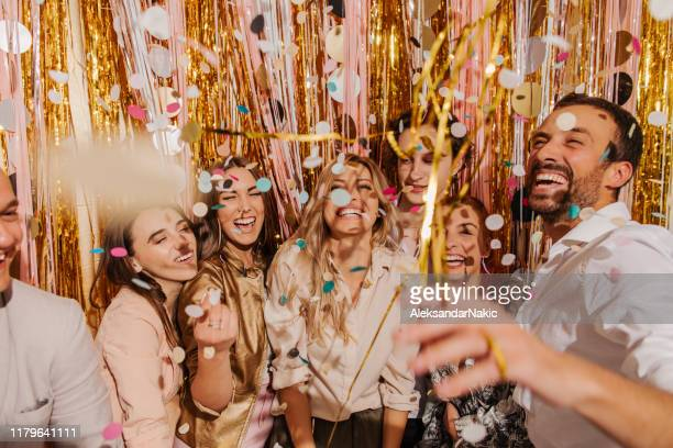 friends celebrating new year's eve - celebration stock pictures, royalty-free photos & images