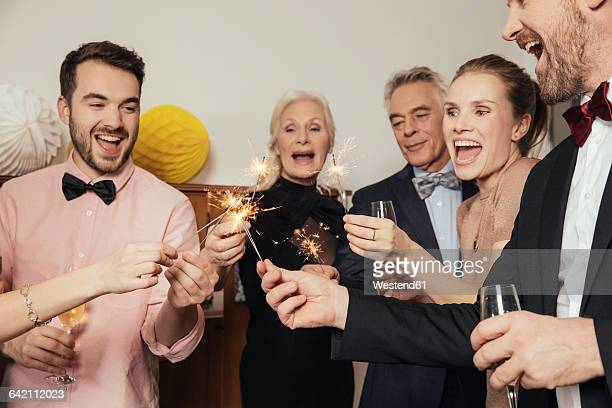 Friends celebrating New Year's Eve together, drinking champagne