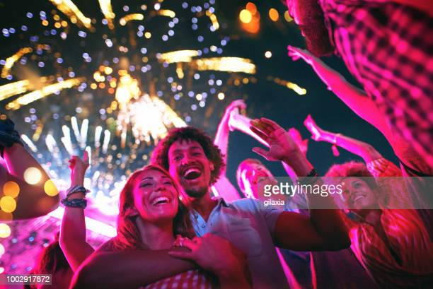 friends celebrating on a night out. - fireworks stock pictures, royalty-free photos & images