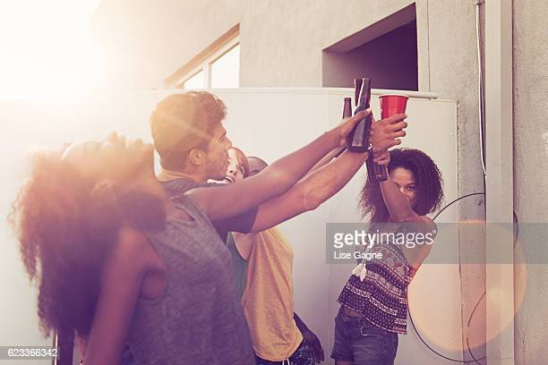 Friends Celebrating on balcony