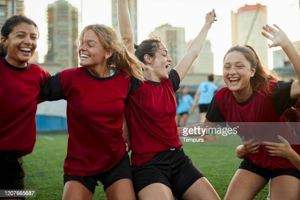 friends celebrating scoring a goal in a soccer match. - the championship football league stock pictures, royalty-free photos & images
