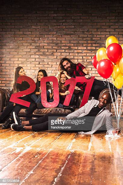 Friends celebrating the new year 2017 together