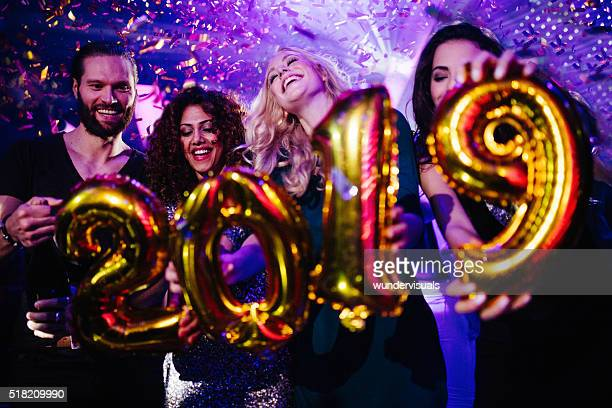 friends celebrating the new years eve in a night club - 2019 stock pictures, royalty-free photos & images