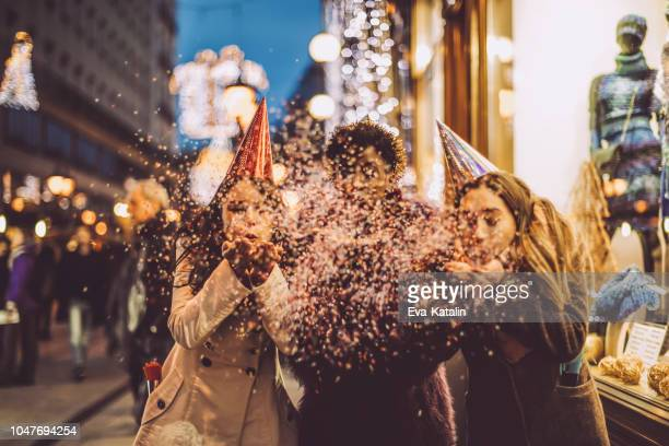 friends celebrating the new year's eve - new year's eve stock pictures, royalty-free photos & images