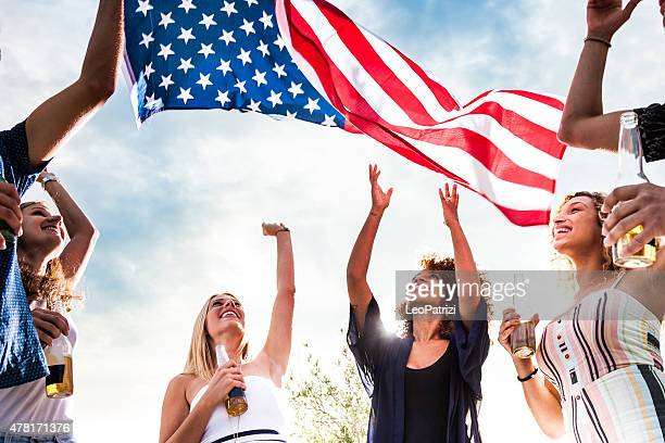 friends celebrating us independence day - fourth of july stock photos and pictures
