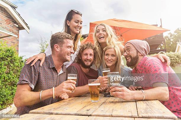 Friends celebrating with some beers at summer party