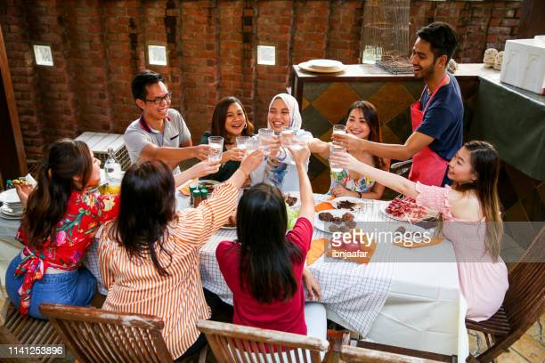 friends celebration and eating - ibnjaafar stock photos and pictures