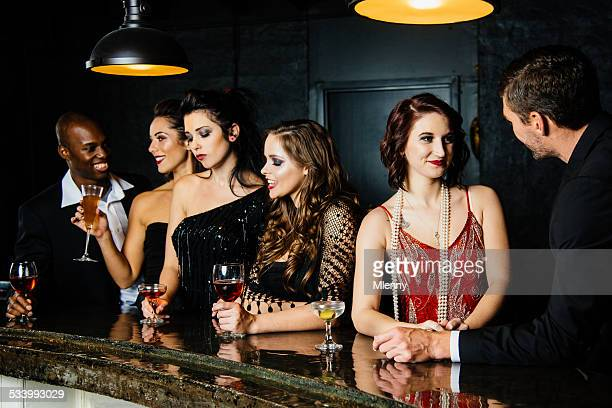 friends chatting and having drinks together at cocktail bar - formal stock pictures, royalty-free photos & images