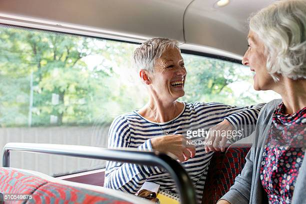 friends chatting on a bus - short hair stock pictures, royalty-free photos & images