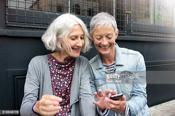 friends chatting outside a cafe - leanincollection stock pictures, royalty-free photos & images