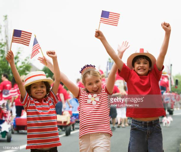 Friends cheering at fourth of July celebration