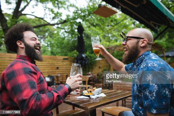 friends cheering for the good times - best sunglasses for bald men stock pictures, royalty-free photos & images