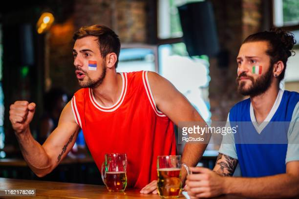 friends cheering for their basketball teams - serbia stock pictures, royalty-free photos & images