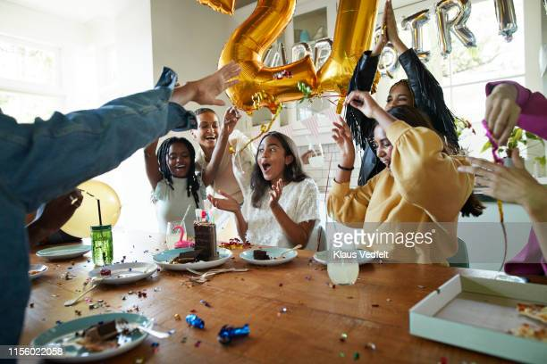 friends cheering for woman in birthday party - 21st birthday stock pictures, royalty-free photos & images