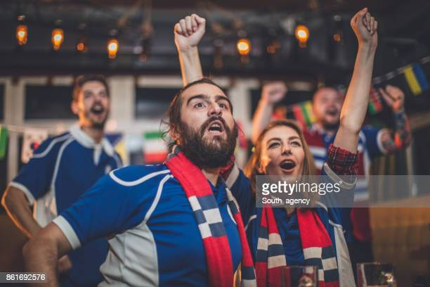 friends cheering - match sport stock pictures, royalty-free photos & images