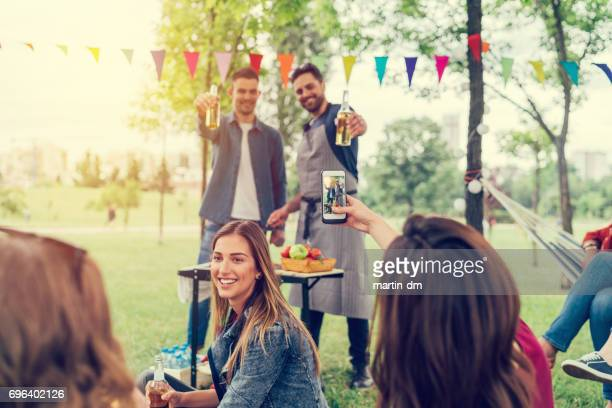 Friends cheers at barbecue party