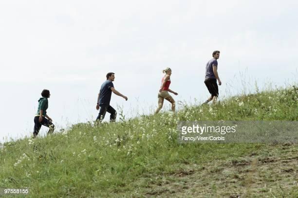 Friends climbing a hill