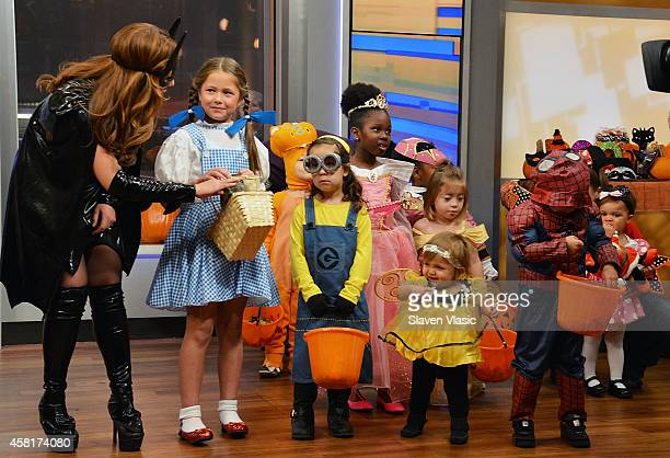 FOX Friends cohost Maria Molina as Bat Girl and guests attend FOX Friends' 2014 Halloween Celebration at FOX Plaza on October 31 2014 in New York City