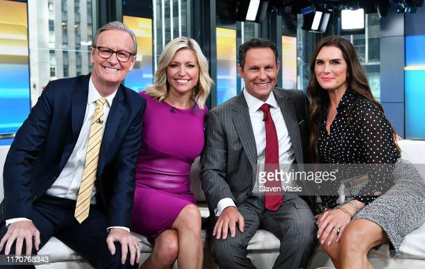 FOX Friends cohosts Steve Doocy Ainsley Earhardt Brian Kilmeade and actress Brooke Shields pose for photos during FOX Friends at Fox News Channel...