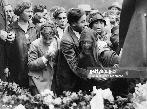 Friends comfort gangster Frankie Yale's exwife at the gangster's funeral