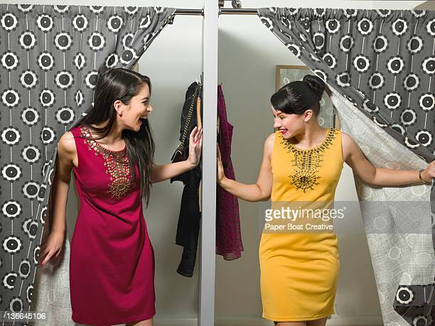 friends coming out of changing room in same dress