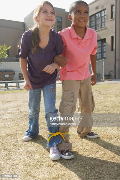 Friends competing in three-legged race