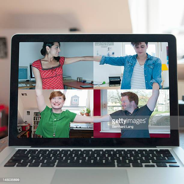 4 friends connecting online, displayed on laptop