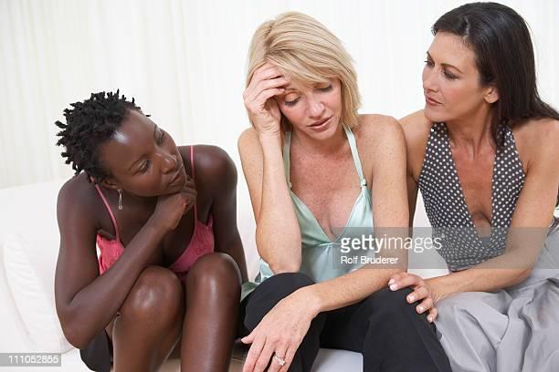 Friends consoling sad woman
