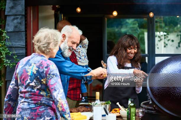 friends cooking healthy food on barbecue - celebratory event stock pictures, royalty-free photos & images