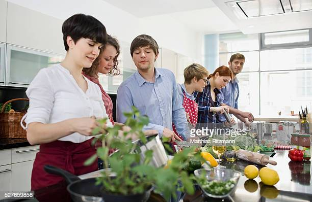 Friends cooking in kitchen