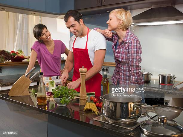 Friends cooking in the kitchen.