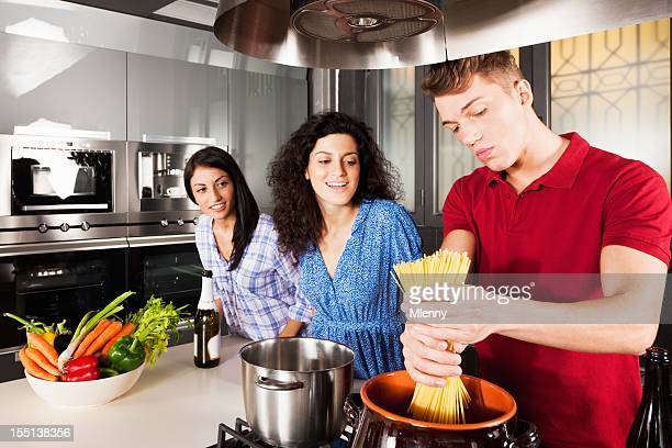 Friends Cooking Together in Modern Kitchen